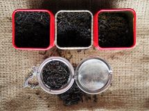 Earl grey blend tea with its ingredients of black tea and bergamot flavour in tin boxes on jute canvas.  Stock Image