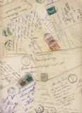 Early 900 postcards. A background made by early 900s' postcards showing old handwritings, stamps and postmarks Stock Photography
