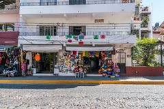 Early afternoon lull in shopping traffic at a souvenir and gift. PUERTO VALLARTA, MEXICO - March 10 2018: Outdoor view of souvenir and gift store in the city royalty free stock images