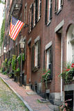 Early America's Acorn Street In The Commonwealth of Massachusett. Walking up the cobblestone alley called Acorn Street lined with brick buildings, brick Royalty Free Stock Photo