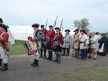 Early American Colonists-Trail of History. McHenry County's Trail of History reenactment of American colonists and soldiers marching with  with camp in the Royalty Free Stock Photography