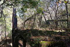 Early American Country Bridge in Ruin. Rusting ruin of a rural bridge over a creek in south Alabama Stock Image