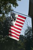 Early American flag is backlit in Yorktown, Colonial National Historical Park, Yorktown, Virginia Royalty Free Stock Photography