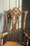Early American hand carved chair with sun design Stock Photography