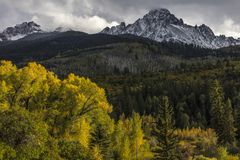 Early autumn color leads to Mount Sneffels and San Juan Mountain. September 23, 2017 - Early autumn color leads to Mount Sneffels and San Juan Mountains in stock photography