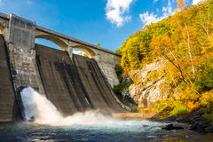 Early autumn color and Prettyboy Dam, on the Gunpowder River in Royalty Free Stock Photo