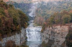Early Autumn colors at dusk surround the majestic Middle and Upper Waterfalls Stock Images