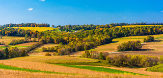 Early-autumn view of rolling hills in rural York County, Pennsylvania. stock photos