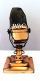 Early BBC Microphone. An early microphone used by the BBC (British Broadcasting Corporation) in the 1930s. A symbol of early broadcasting Stock Photo