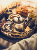 Early breakfast in bed: vintage coffee pot, Cup of coffee and croissants, close up Royalty Free Stock Images