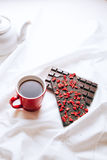 Early breakfast in silence with chocolate bar and tea Stock Images