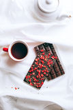 Early breakfast in silence with chocolate bar and tea Stock Image