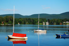 An early calm on a Berkshire Lake. Boats are at rest on Laurel Lake in the Berkshires royalty free stock photography
