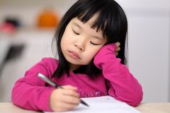 Early childhood education concept with little girl learn to write royalty free stock image
