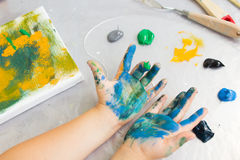 Early childhood education. Dirty little painter royalty free stock photos