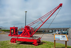 Early crane at Hopeman. An orange painted crane originally used in Wick now installed at the harbor on the east of Scotland tourist trail at Hopeman as a Royalty Free Stock Photos