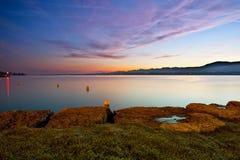 Early Dawn At Lake Geneva. Dawn at Lake Geneva, Switzerland with Chablais Alps in the background Royalty Free Stock Photos