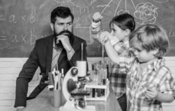 Early development of children. back to school. microscope optical instrument at science classroom. happy children royalty free stock images