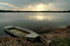 Early evening on pond. And dinghy Royalty Free Stock Images