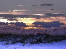 Early evening summer sunset at Pensacola beach, Florida. Purple and peach summer sunset in the early evening at Pensacola Beach, Florida Stock Image