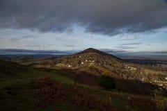 The Malverns. Early evening sun rakes accross the Malvern hills Stock Image