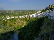 Early evening sunset light falling on the town of Arcos de La Frontera, Andalucia, Spain stock photos