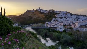 Early evening sunset light falling on the town of Arcos de La Frontera, Andalucia, Spain stock images
