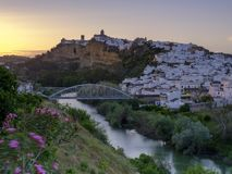 Early evening sunset light falling on the town of Arcos de La Frontera, Andalucia, Spain stock image