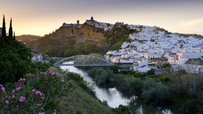 Early evening sunset light falling on the town of Arcos de La Frontera, Andalucia, Spain stock photo