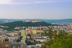 Aerial evening view on Brno city, houses skyscrapers and fortress Spilberk from hill. Beautiful panorama around exhibition centre. Early evening view on Brno royalty free stock photos