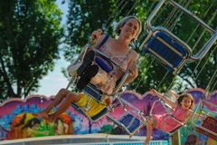 Early fair in Ouchy Lausanne. Mother with children have a lot of fun in de carousel stock photo