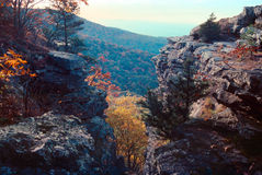 Early fall in the ozarks. View of Magazine mountain and fall foliage through a crevasse stock photo