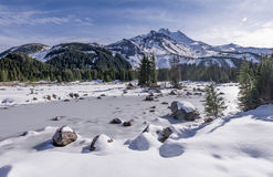 Early Fall Snow in the Mt Jefferson Wilderness. A fall snow storm starts the lakes in Jefferson Park below Mt Jefferson to freeze.  Mt Jefferson Wilderness Area Royalty Free Stock Photos