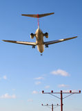 Early flight on final approach. Early flight on short final to the runway Royalty Free Stock Images