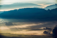 Early fogy autumn morning on the Czech Austrian border. Misty woods and field, Europe landscape