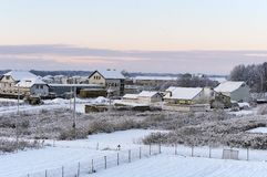 Early frosty morning, dawn in winter in the village. Dawn in winter in the village, early frosty morning royalty free stock images