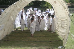 EARLY LEARNING CHILDREN WORSHIP HAJJ Royalty Free Stock Photos