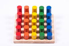 Early Learning Toy: Cylinders of Different Colors and Height. Developmental Toy: Bright Multi-Colored Cylinders stock photo