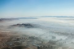 Early Mist. This photo was taken just before the plane landed in the morning in Chifeng which is in the north of China royalty free stock photo