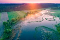Aerial view of countryside and river at sunrise Stock Image