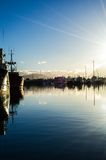 Early Morining Harbor. Dawn breaks over small boat commerical harbo Stock Images