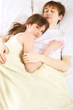 Early morning. A young couple sleeping together Royalty Free Stock Images