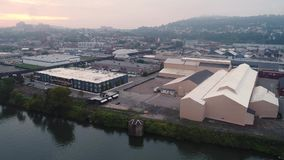 Early Morning Aerial Establishing Shot of Lawrenceville, PA. 9243 An early morning foggy aerial establishing shot of the Lawrenceville area in Pittsburgh stock video footage