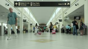 Early morning airport travelers stock footage