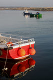 Early Morning, Amble Harbour, Red boat. Peaceful learly morning scene, Amble Harbour, Red fishing boat with abstract reflection Royalty Free Stock Photo
