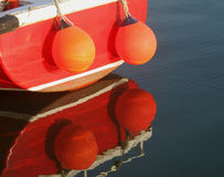 Early Morning, Amble Harbour, Red boat. Peaceful learly morning scene, Amble Harbour, Red fishing boat with abstract reflection Royalty Free Stock Photography