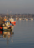 Early Morning, Amble Harbour, Red boat Royalty Free Stock Photos