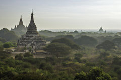 Early morning at Bagan. Ancient temples scattered around plains shrouded in early morning mist stock photography