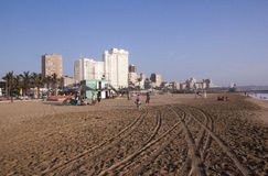 Early Morning Beachgoers on Durban's North Beach royalty free stock photography