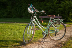 Early morning biking. Old fashioned bike in the early morning light Stock Image